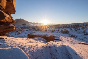 sunrise over snow and red stones, Capitol Reef National Park