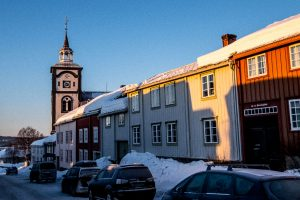 Wooden buildings, church, street scene, Røros, Norway