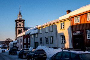 Wooden buildings, church, street scene, Røros, Norway