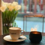 Cappuccino cup, candles, tulips, Trygstad Bakeri, Røros, Norway